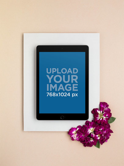 iPad Mockup Over a Neutral Backdrop Bordered by Magenta Colored Flowers 22554