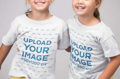 T-Shirt Mockup of Twin Sisters Smiling 22521