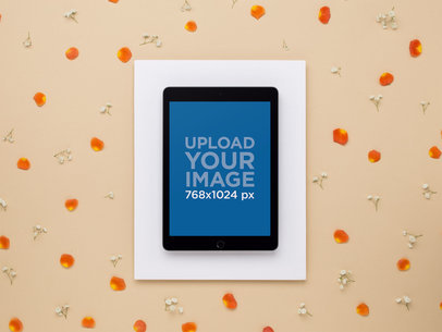 Mockup of an Ipad Lying Beside Scattered Flower Petals 22555