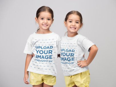 Round Neck T-Shirt Mockup of Twin Girls at a Photo Studio 22522