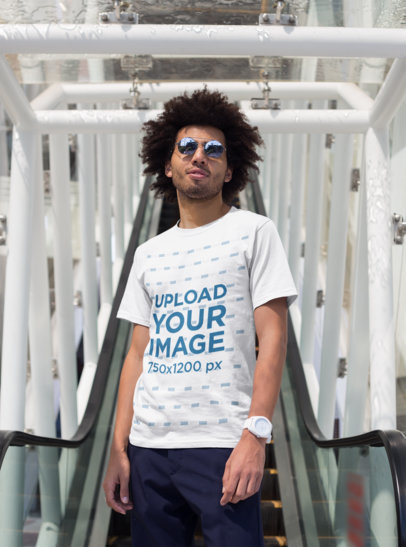 T-Shirt Mockup Featuring a Man with an Afro Looking at the Camera 22260