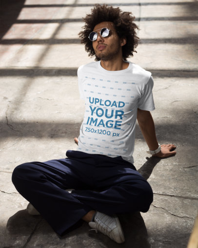 Mockup of a Man Wearing a T-Shirt Sitting on the Floor 22259
