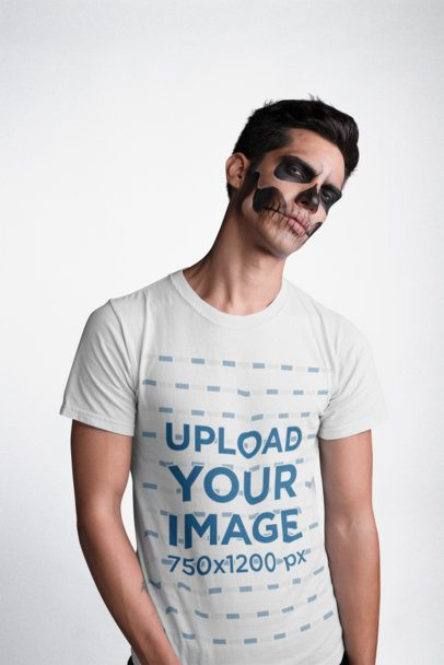 Mockup of a Man Wearing a T-Shirt and Serious Skeleton Halloween Makeup 22938