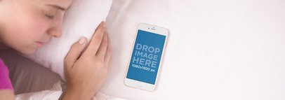 iPhone 6 Mockup of a Girl Sleeping Next to her iPhone in Bed