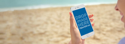 iPhone 6 Mockup of a Woman Holding an iPhone at the Beach a3205