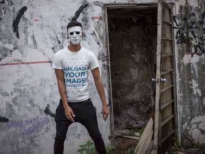 Crewneck Tee Mockup of a Man with a Mask Outside a Haunted House 22945