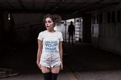 Tshirt Mockup of a Girl with Halloween Makeup with a Dark Figure Behind Her 22929