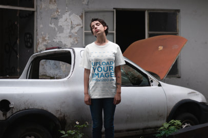 Mockup of a Girl Wearing a Unisex T-Shirt Against a Rusty Car 22748