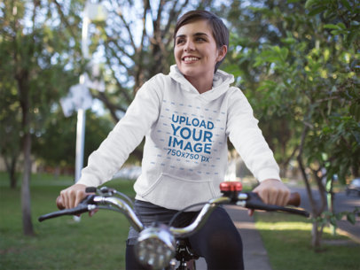Hoodie Mockup of a Girl Riding a Bike at a Park 17924