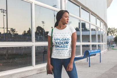 Round Neck Tee Mockup of a Woman with Braids Looking at the Horizon 18177