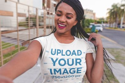 Selfie T-Shirt Mockup of a Girl with Braids Walking Down the Street 18179