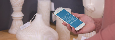 iPhone 6 Mockup Featuring a Woman at a Furniture Store a3124