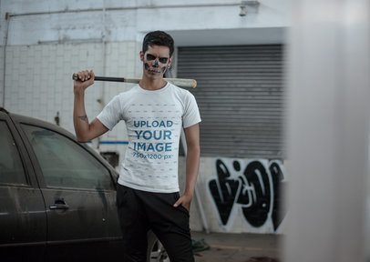 Mockup of a Man With a Bat Wearing a T-shirt 23020