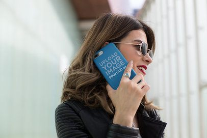 Mockup of a Woman Holding a Phone Case Against her Face 22893