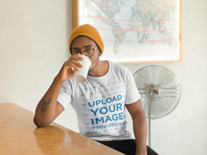 Mockup of a Man Wearing a T-Shirt and Beanie Drinking Coffee 21034