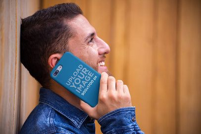 Phone Case Mockup Featuring a Smiling Man Talking on the Phone 22876