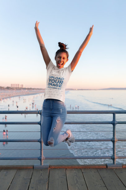 T-Shirt Mockup of a Girl Jumping on a Pier at the Beach 18217