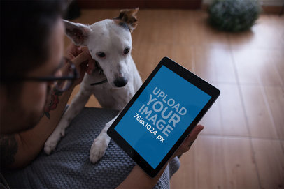 iPad Mockup Featuring a Man Petting His Dog at Home 22834