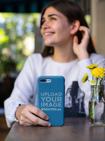 Mockup of a Smiling Girl Holding a Phone Case 22885