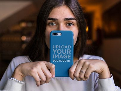 Mockup of a Girl Holding an iPhone Case in Front of Her Face 22886