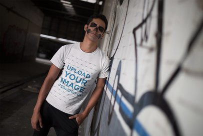T-Shirt Mockup of a Man with Scary Halloween Makeup Against a Graffiti 23025
