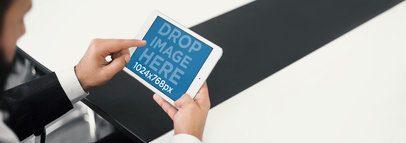 Mockup of an Executive Man Using an iPad Mini at a Conference Room a4050