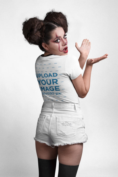 Back View T-Shirt Mockup of a Girl with Spooky Halloween Makeup at a Photo Studio 22917