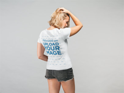 Mockup of a Woman Wearing a T-Shirt and Denim Shorts Touching Her Hair 22330