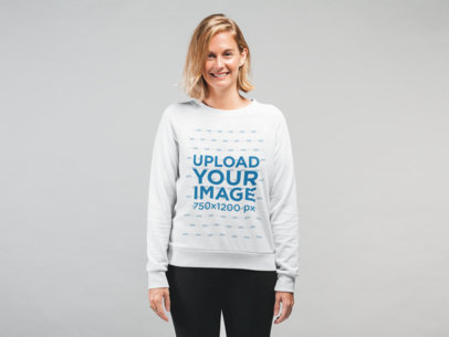 Sweatshirt Mockup Featuring a Blonde Woman Smiling in a Studio 22320