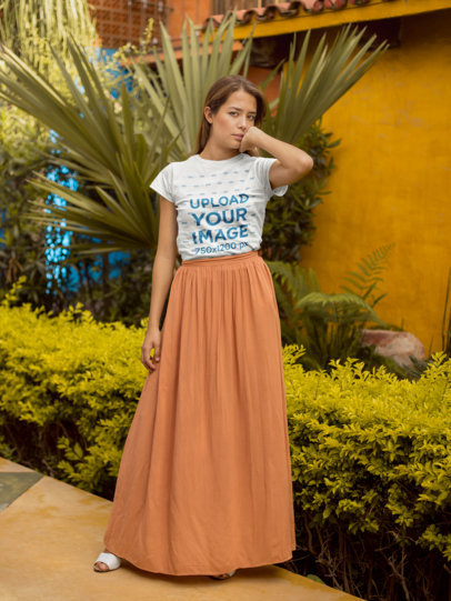 Round Neck T-Shirt Mockup Featuring a Girl with an Orange Long Skirt Outside a House 22507