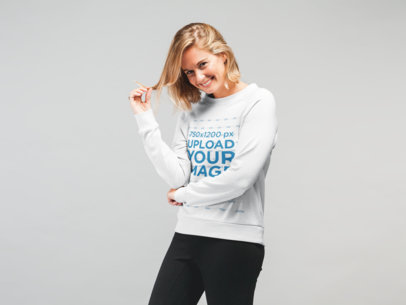 Mockup of a Happy Woman Wearing a Sweatshirt While Playing with Her Hair 22321