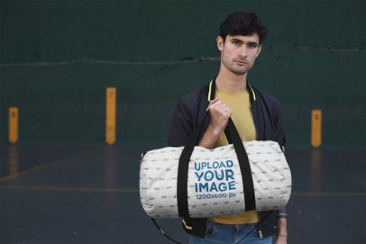 Mockup of a Young Man Carrying a Duffle Bag 23227