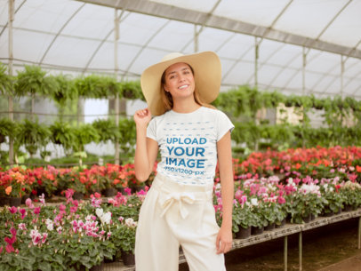 Mockup of a Happy Girl Wearing a Tshirt in a Greenhouse 22502