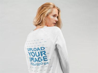Mockup of a Woman Wearing a Sweatshirt in Back View in a Studio 22325