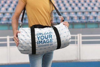 Mockup of a Man Carrying a Kit Bag at a Stadium 23218