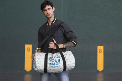 Mockup of a Man Holding a Gym Bag 23243