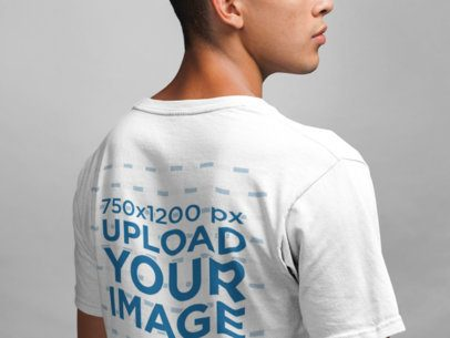 Closeup Back View T-Shirt Mockup of a Man in a Studio 21588