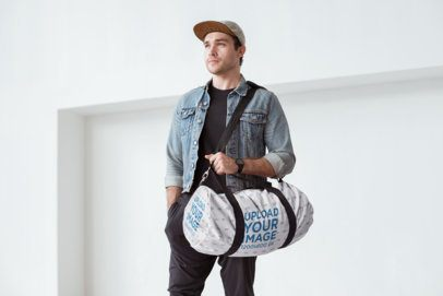 Gym Bag Mockup Featuring a Handsome Man Carrying a Duffel Bag 23052