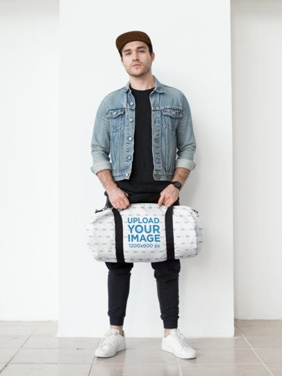 Mockup of a Kit Bag Carried by a Trendy Man 23053