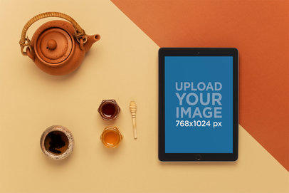 Mockup of an iPad Lying on a Table Next to a Tea Set 22809