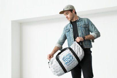 Mockup of a Man Closing His Duffle Bag 23055