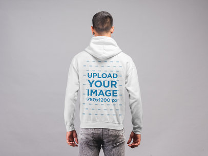 Hoodie Mockup of the Back of a Man Facing Seamless Paper 21557