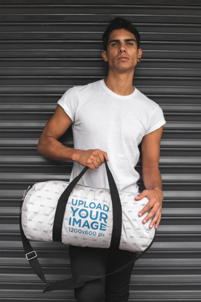 Duffle Bag Mockup of a Man Leaning Against a Closed Store Curtain 23237