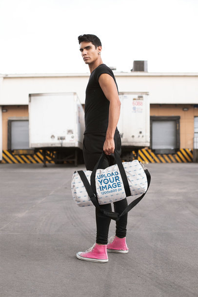 Mockup of an Athletic Man Carrying a Gym Bag 23233