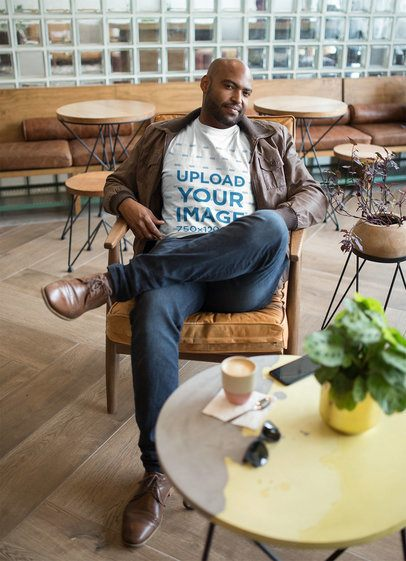 T-Shirt Mockup Featuring a Man in a Cool Café 21698