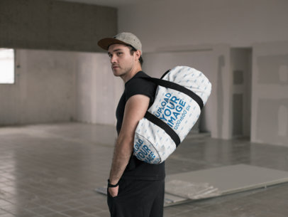 Mockup of a Kit Bag Hanging from a Man's Shoulder 23060