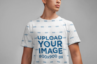 All Over T-Shirt Mockup Featuring a Man in a Studio 21587