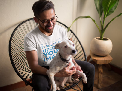Mockup of a Man Wearing a T-Shirt While Holding His Cute Dog 18025