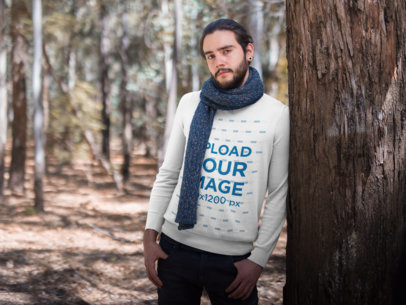 Mockup of a Man Wearing a Sweater and a Scarf while Leaning Against a Tree 18096