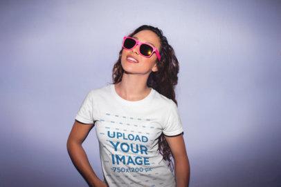 Mockup of a Stylish Woman Wearing a T-Shirt and Bright Pink Sunglasses 22287
